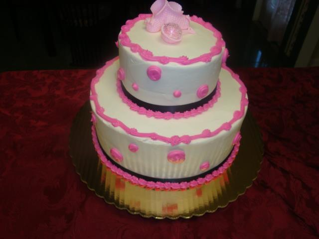 Baby shower cake decorated with pink....it's a girl!