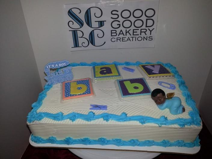 This baby block cake is sure to be a hit at the baby shower.