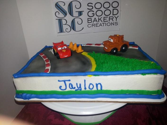 "Any child would be happy with their favorite ""Cars"" characters sitting on their cake."