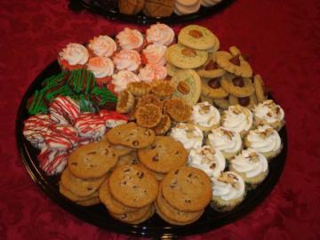 This cookie tray has cupcakes and pecan tassies in addition to delicious cookies.