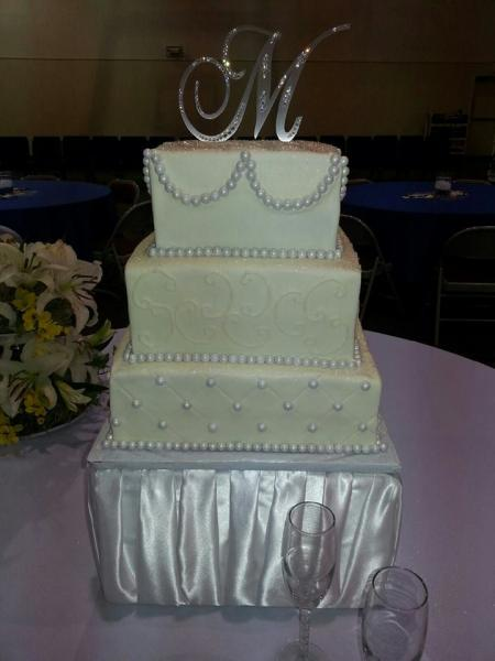 This cake is quite elegant with a silver initial as the topper.